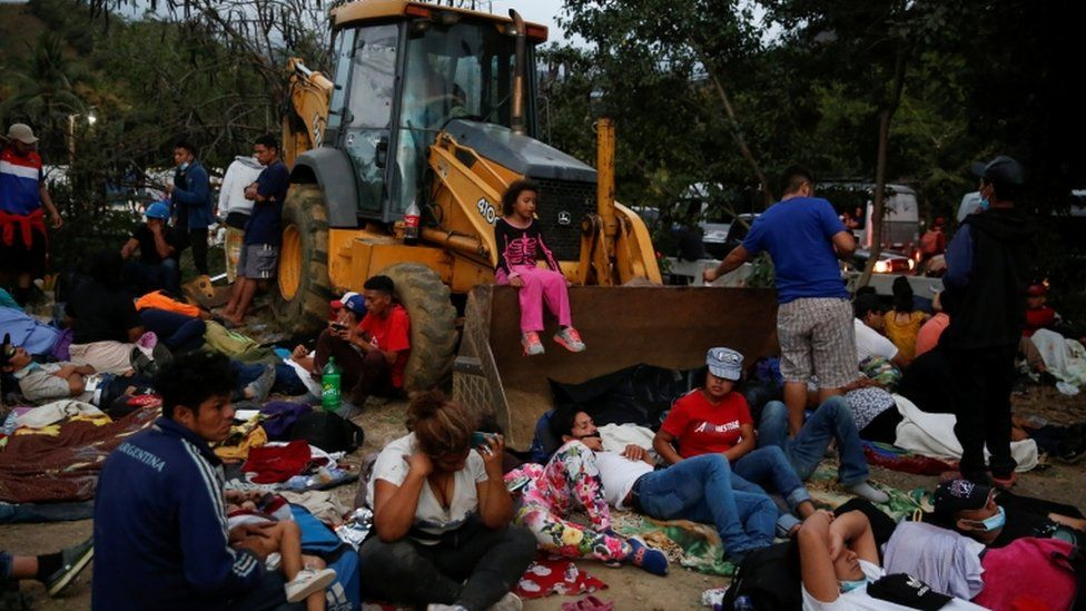 Hondurans taking part in a new caravan of migrants set to head to the United States, take a break in Vado Hondo, Guatemala