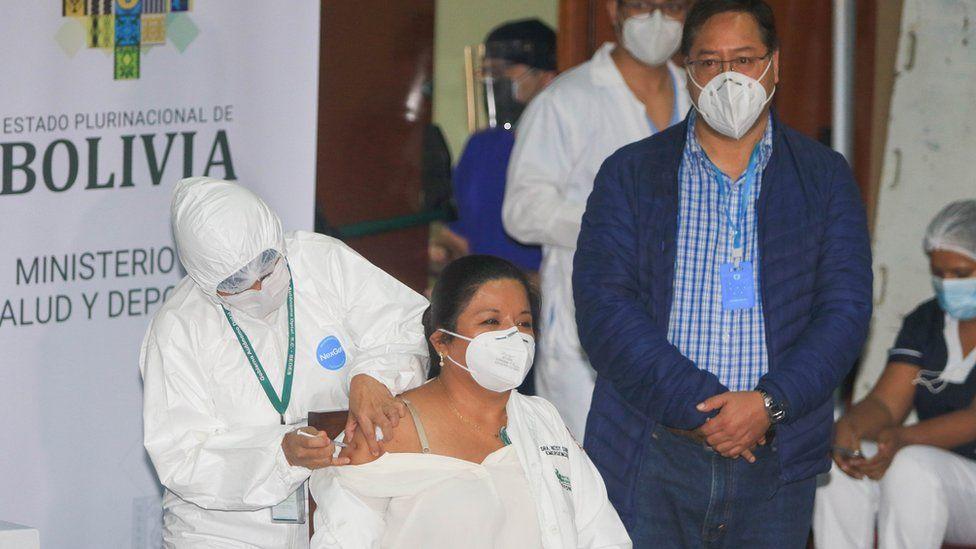 a nurse receives the Russian vaccine in Bolivia