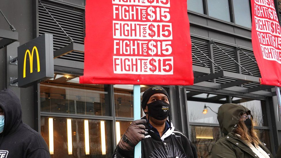 Demonstrators participate in a protest outside of McDonald's corporate headquarters on January 15, 2021 in Chicago, Illinois. The protest was part of a nationwide effort calling for minimum wage to be raised to $ 15-per-hour