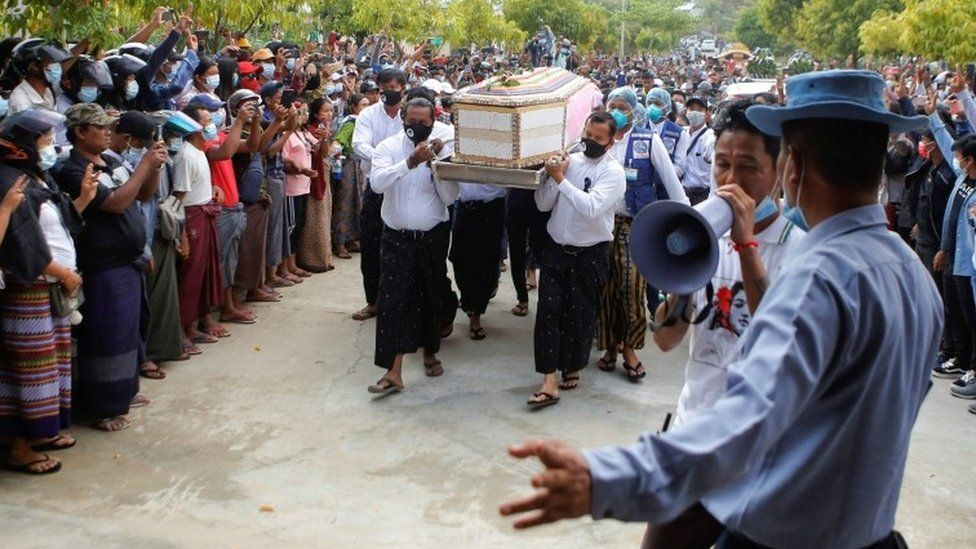 People in Myanmar line the streets to mourn a slain protester