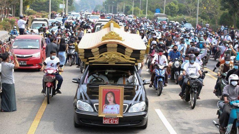 A hearse carries the body of slain Myanmar protester Mya Thwe Thwe Khaing