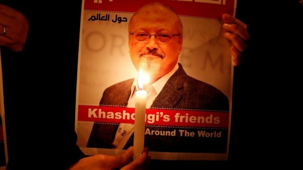 A demonstrator holds a poster with a picture of Saudi journalist Jamal Khashoggi outside the Saudi Arabia consulate in Istanbul, Turkey October 25, 2018.