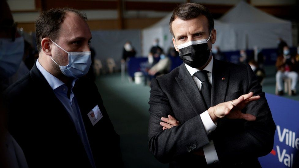 French President Emmanuel Macron visits a COVID-19 vaccination centre in Valenciennes, France March 23, 2021.