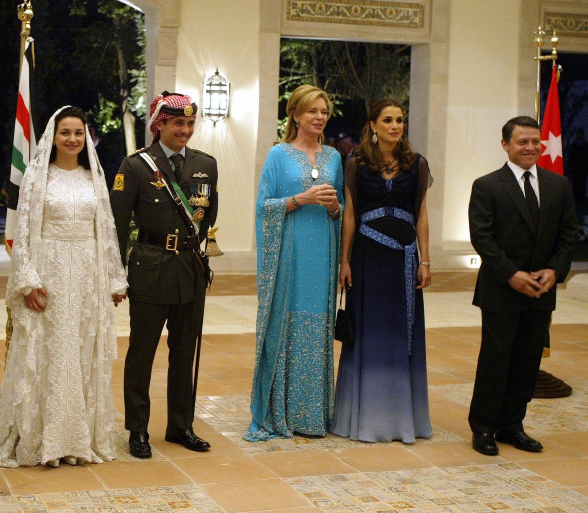 Jordan's King Abdullah II, his wife Queen Rania, Queen Noor, mother of the groom, Crown Prince Hamzeh, the groom, his bride Princess Noor, Sherif Asem bin-Nayef and his ex-wife Firouzeh Vokhshouri, parents of the bride, attend the royal wedding on May 27, 2004 in Amman, Jordan