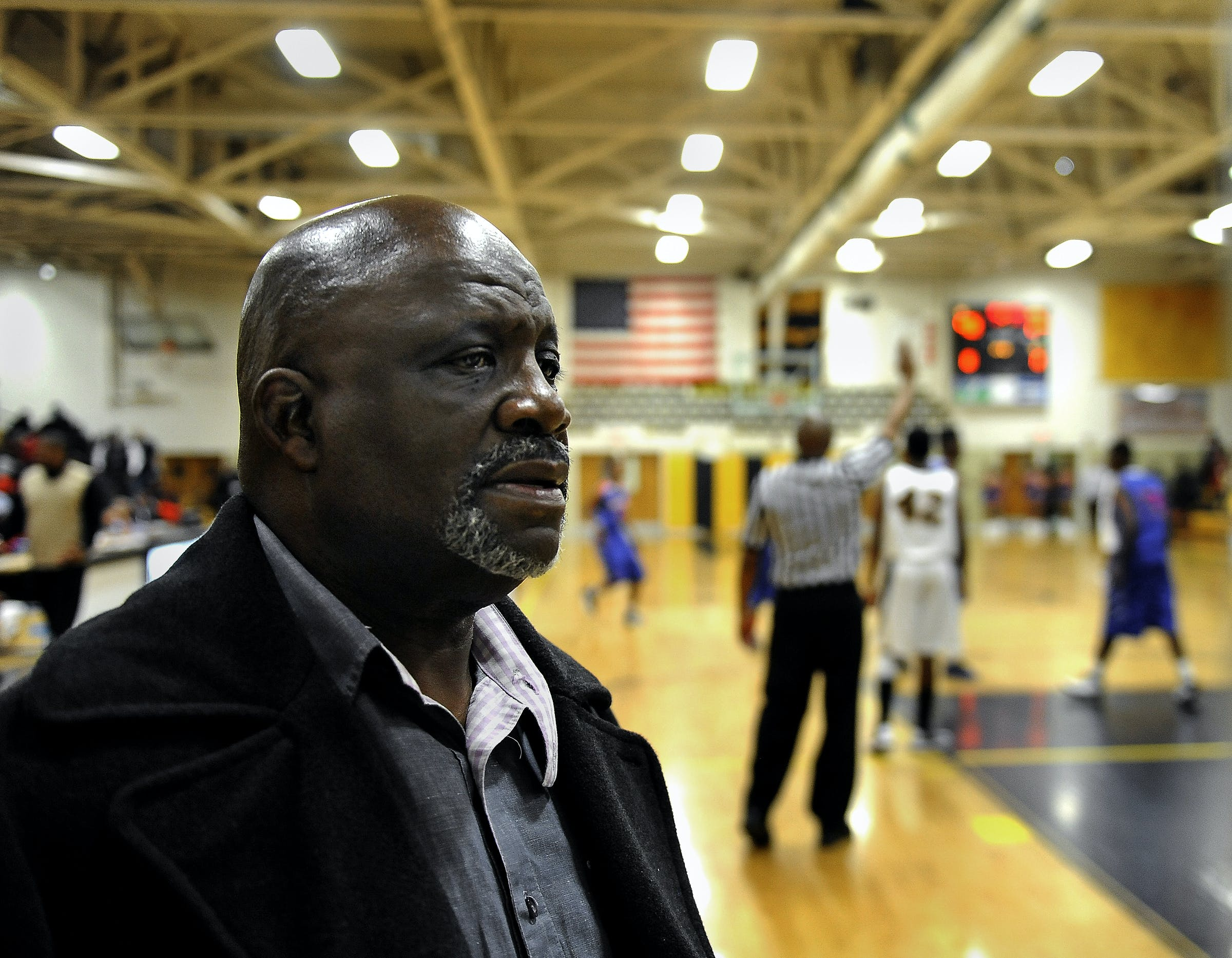 Former executioner Jerry Givens attending a high school basketball game where some of the boys he mentors are playing on Jan. 15, 2013 in Richmond, VA.